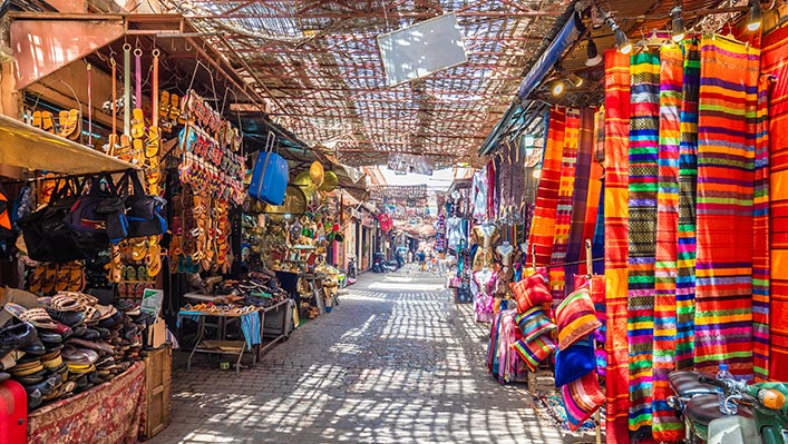 A colourful market with colourful clothing and items